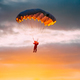 Skydiver On Colorful Parachute In Sunny Sky - PhotoDune Item for Sale
