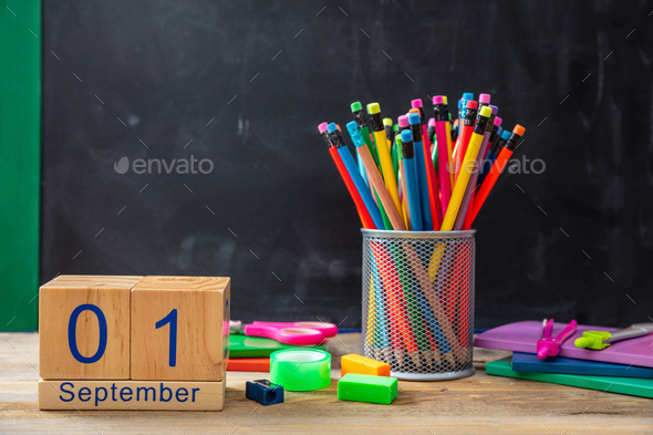 September 1st date and colorful school supplies on blackboard background - Stock Photo - Images