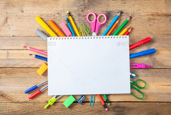 Back to school. School supplies and blank notebook on wooden background, space for text - Stock Photo - Images