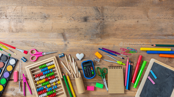 Back to school. School supplies on wooden background, top view - Stock Photo - Images