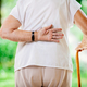 Elderly woman outdoors with back pain - PhotoDune Item for Sale