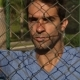 Guy Leaning Against Fence - VideoHive Item for Sale