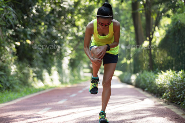 Woman runner with sports injured knee - Stock Photo - Images