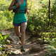Woman trail runner running on sunny forest trail - PhotoDune Item for Sale