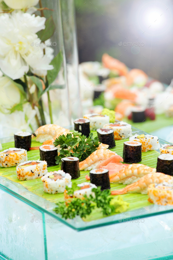 Display of assorted types of fresh sushi - Stock Photo - Images