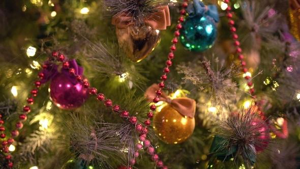 Christmas Tree Toys Decoration.A Christmas Tree Decorated With Christmas Tree Toys And Shining Lights Christmas Tree Gold Bokeh