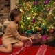 Christmas Gift Surprise A Little Girl Opens a Christmas Present in Amazement - VideoHive Item for Sale