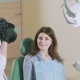 A Dark-haired Dentist Takes Pictures of Her Patient - VideoHive Item for Sale