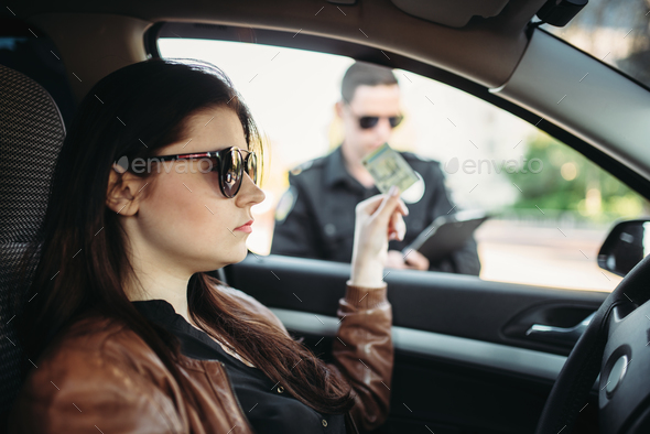 Male cop in uniform writes a fine to female driver - Stock Photo - Images