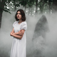 Female victim in white dress in the misty forest - PhotoDune Item for Sale