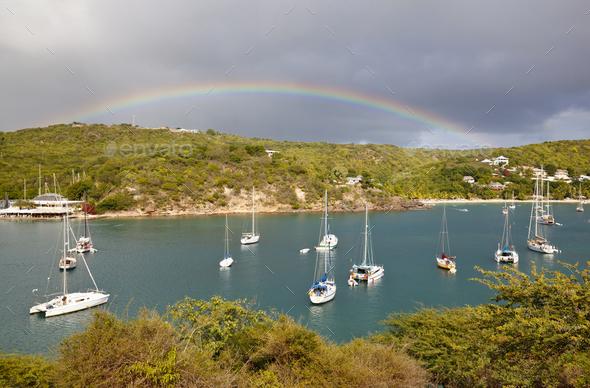 Caribbean Harbor With Sailboats And Rainbow, Antigua - Stock Photo - Images