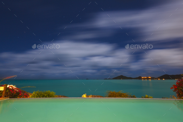 Pool And Caribbean Sea At Night, Antigua - Stock Photo - Images