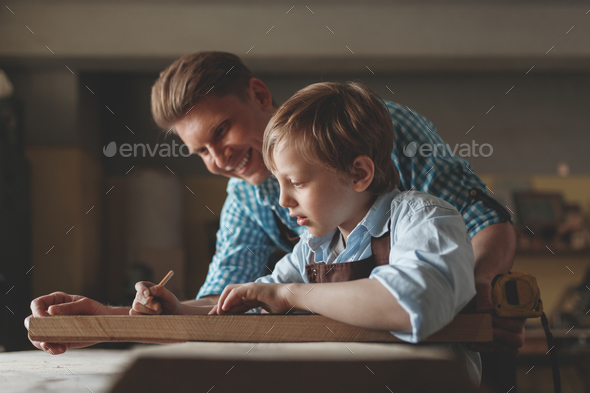 Father and son carpentry - Stock Photo - Images