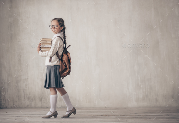 Little schoolgirl with books - Stock Photo - Images
