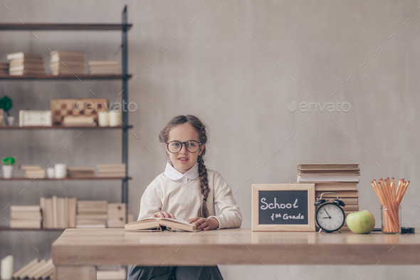 Little girl with a book - Stock Photo - Images