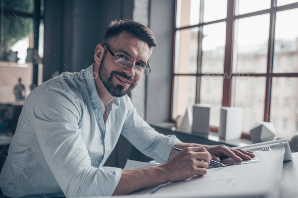 Smiling mature man at work - Stock Photo - Images