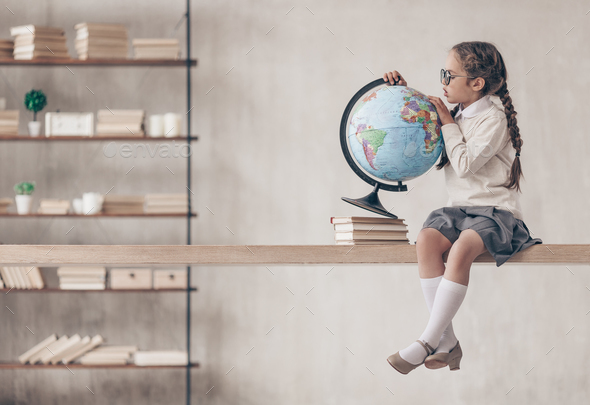 Little schoolgirl with a globe - Stock Photo - Images