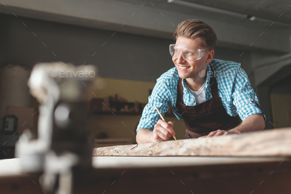 Young smiling carpenter at work - Stock Photo - Images