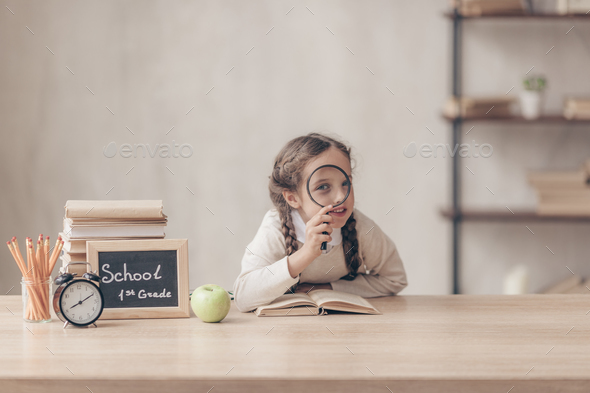 Little girl with a magnifer - Stock Photo - Images