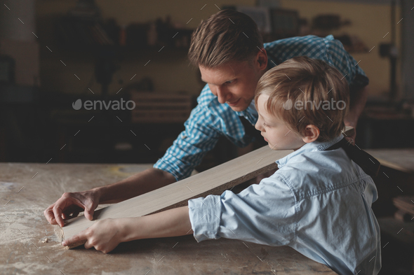 Working father and son indoors - Stock Photo - Images