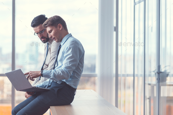 Young business people at work - Stock Photo - Images