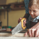Little boy sawing a plank - PhotoDune Item for Sale