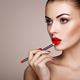 Beautiful woman paints lips with lipstick - PhotoDune Item for Sale