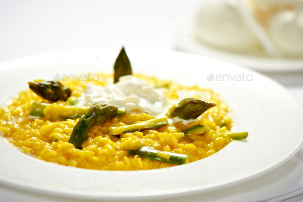 Plate of saffron risotto with fresh asparagus tips - Stock Photo - Images