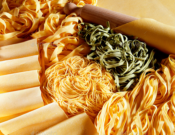 Display of dried uncooked handmade Italian pasta - Stock Photo - Images