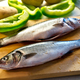Whole fresh caught sea bass on a chopping board - PhotoDune Item for Sale