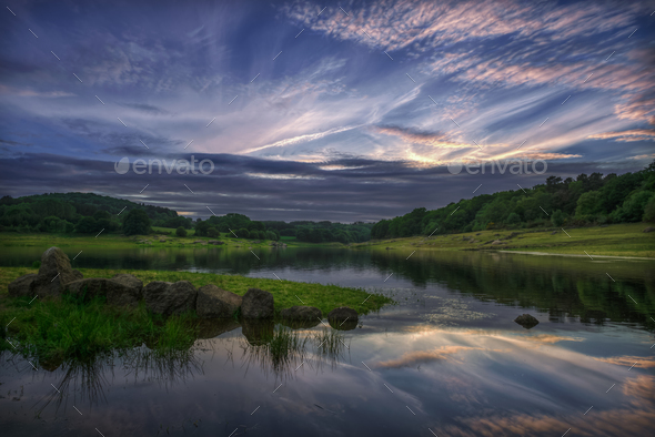 Cloudy sunset over the river Miño - Stock Photo - Images