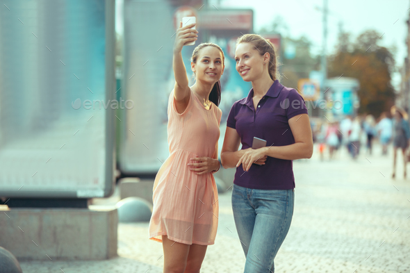 Young Beautiful Women Talking On Mobile Phone Outdoor. - Stock Photo - Images
