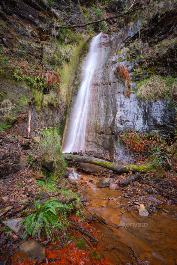 The red ferruginous waters of the Rexio waterfall - Stock Photo - Images