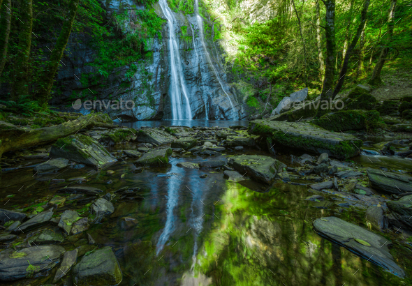 The waterfall of Vilagocende and its reflection in a pond - Stock Photo - Images