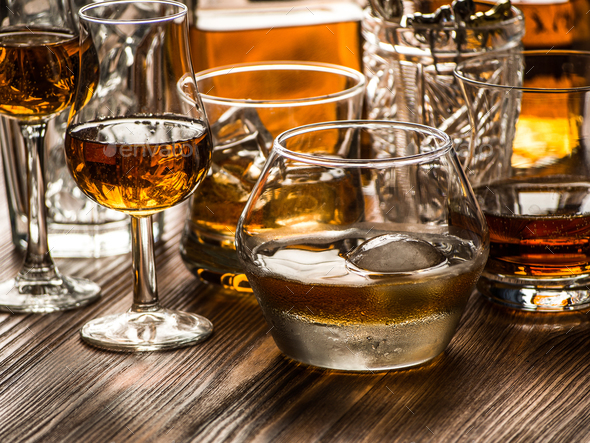 Varous glasses of whiskey on a table - Stock Photo - Images