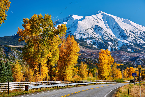 Highway in Colorado Rocky Mountains at autumn - Stock Photo - Images