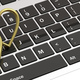 Pair of golden wedding rings isolated on computer laptop keyboard, banner, 3d illustration - PhotoDune Item for Sale