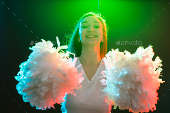 Blonde cheerleader woman posing with pom-poms at dancing studio - Stock Photo - Images