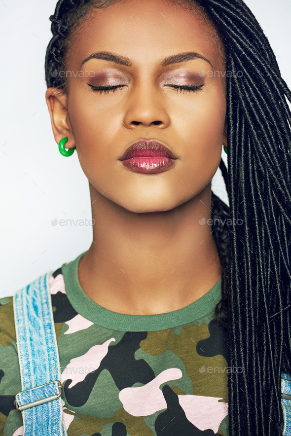Gorgeous young African woman wearing subtle makeup - Stock Photo - Images