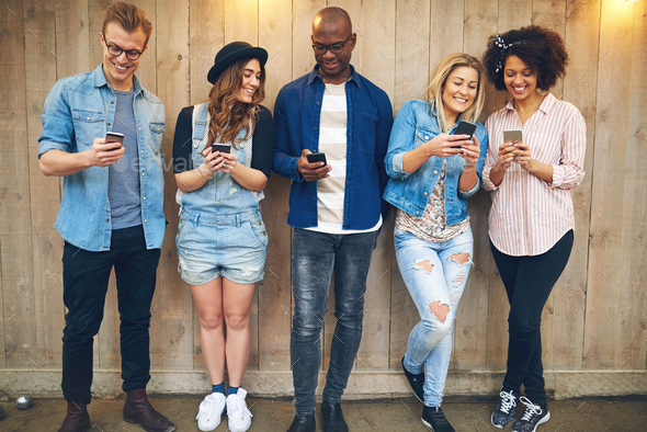 Friends using smartphones - Stock Photo - Images