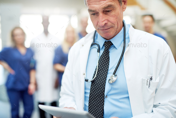 The medicine specialist with tablet in hospital - Stock Photo - Images