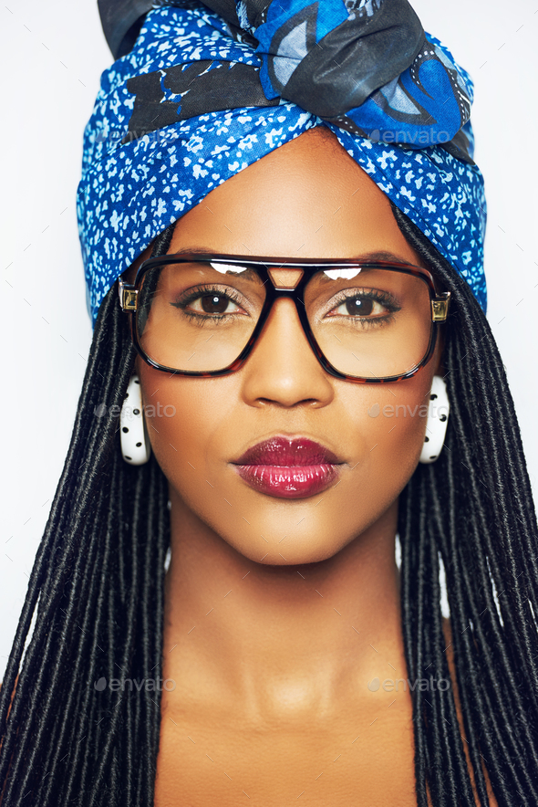 Black woman in glasses and headscarf - Stock Photo - Images