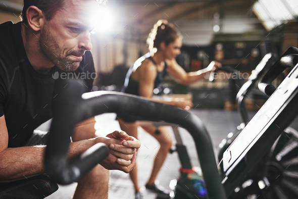 Male and woman taking rest after workout - Stock Photo - Images