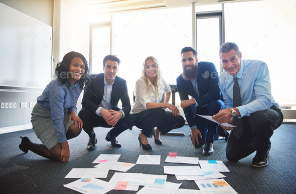 Smiling business team with ideas - Stock Photo - Images