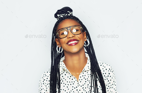 Smiling young black woman in glasses - Stock Photo - Images