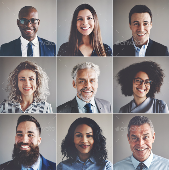 Smiling group of ethnically diverse professional businessmen and businesswomen - Stock Photo - Images