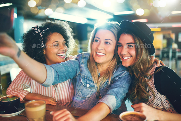 Three fun young women posing for a selfie - Stock Photo - Images