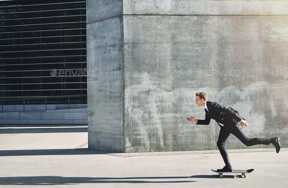 Businessman on a skateboard moving forward fast - Stock Photo - Images