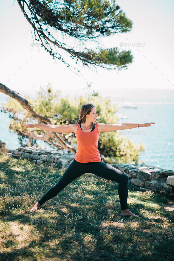 Woman practicing yoga - Stock Photo - Images
