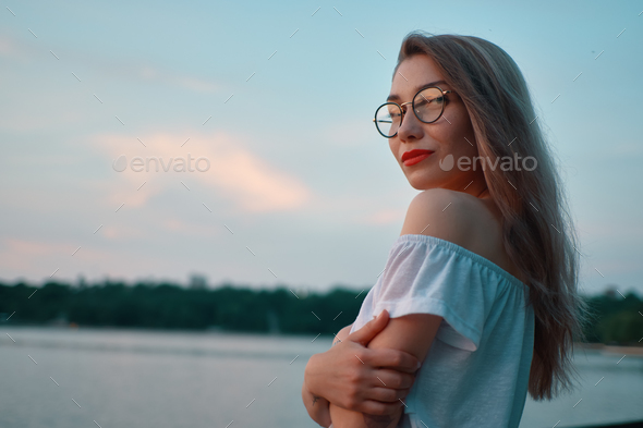 Attractive girl wearing glasses on park lake view - Stock Photo - Images